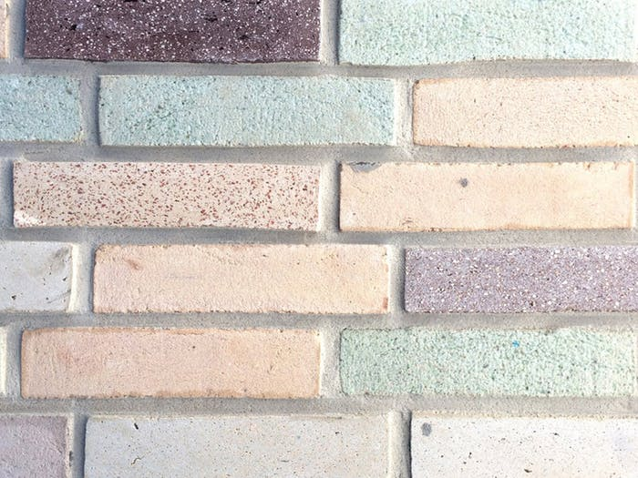 "A wall of colourful and sustainable bricks.<span class=""sr-only""> (opened in a new window/tab)</span>"
