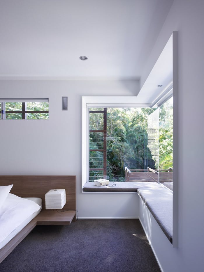 """Window seat in a modern bedroom, great option to create a refuge area in a biophilic design.<span class=""""sr-only""""> (opened in a new window/tab)</span>"""