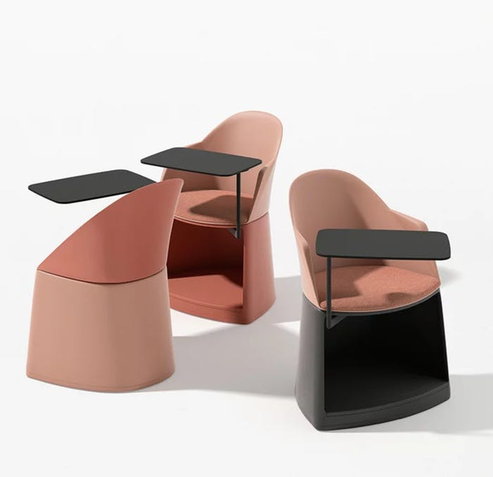 """Chair with small integrated table and a storage unit at the bottom.<span class=""""sr-only""""> (opened in a new window/tab)</span>"""