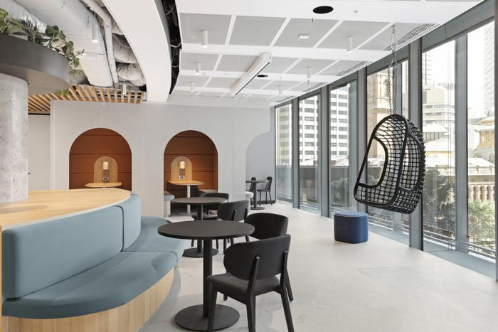 """Common office area with a prevalence of curved lines in the design.<span class=""""sr-only""""> (opened in a new window/tab)</span>"""