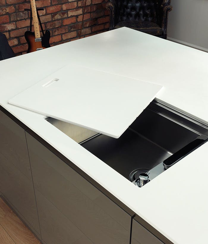 """Sliding a cover manually over the kitchen sink to make it invisible.<span class=""""sr-only""""> (opened in a new window/tab)</span>"""
