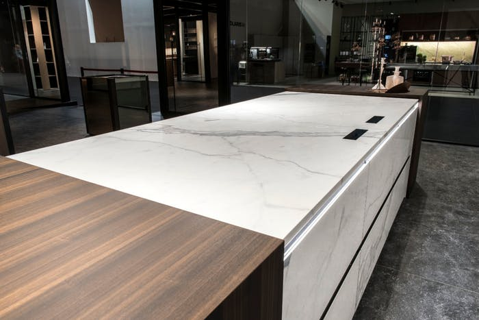 """Seamless kitchen countertop, integrating a hidden induction hob.<span class=""""sr-only""""> (opened in a new window/tab)</span>"""