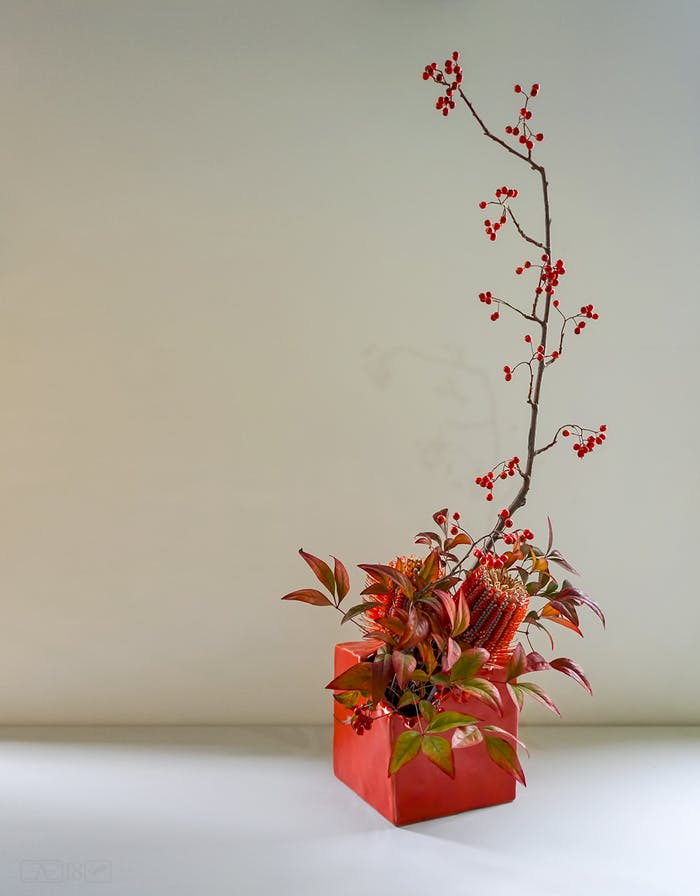 """Totally asymmetric Ikebana arrangement, perfect décor in a minimalist interior.<span class=""""sr-only""""> (opened in a new window/tab)</span>"""