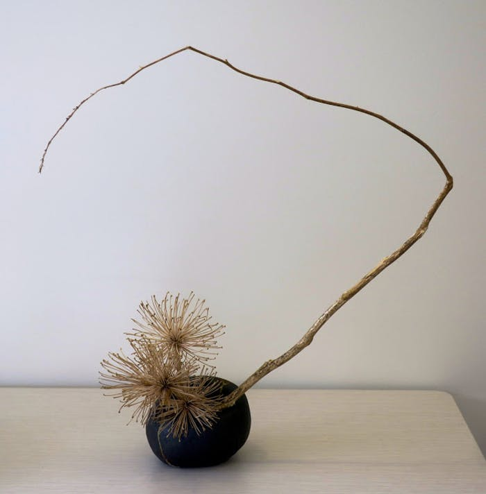 """Ikebana arrangement of dried branches, perfect décor in a minimalist interior.<span class=""""sr-only""""> (opened in a new window/tab)</span>"""