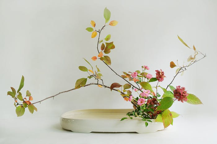 """Ikebana arrangement made of local leaves and flowers.<span class=""""sr-only""""> (opened in a new window/tab)</span>"""
